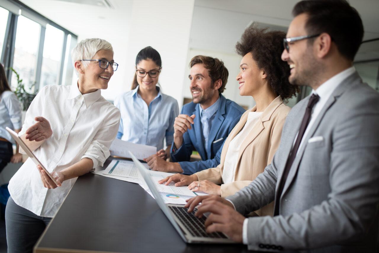 https://enterprise-eq.com/wp-content/uploads/2021/05/happy-business-colleagues-in-modern-office-working-V9Q5MU2-1280x853.jpg